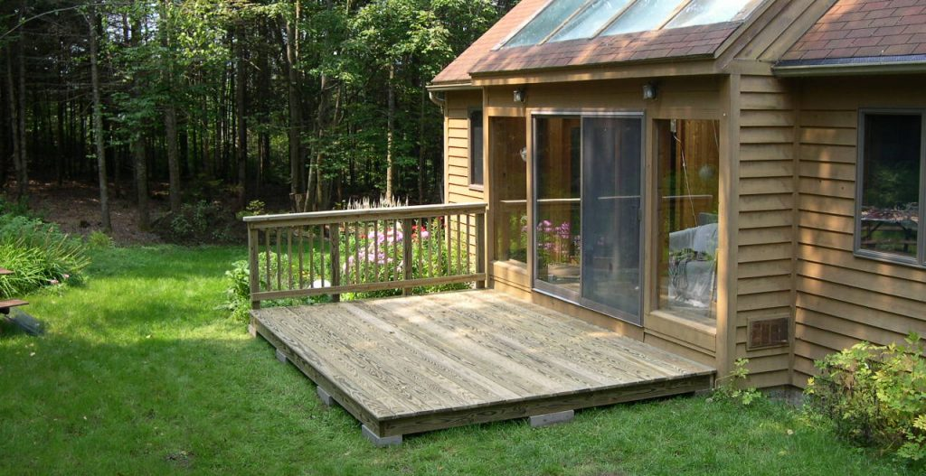 Small back deck adds functionality to this home.